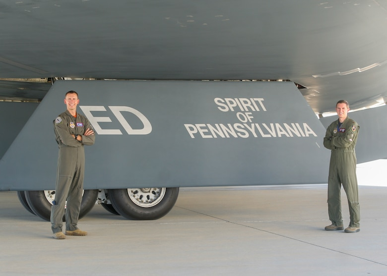 """The 419th Flight Test Squadron's Maj. Dustin Duke and Maj. Matthew Gray pose with the B-2 """"Spirit of Pennsylvania"""" after its arrival to Edwards Air Force Base, California, Oct. 2. (Air Force photo by Kyle Brasier)"""