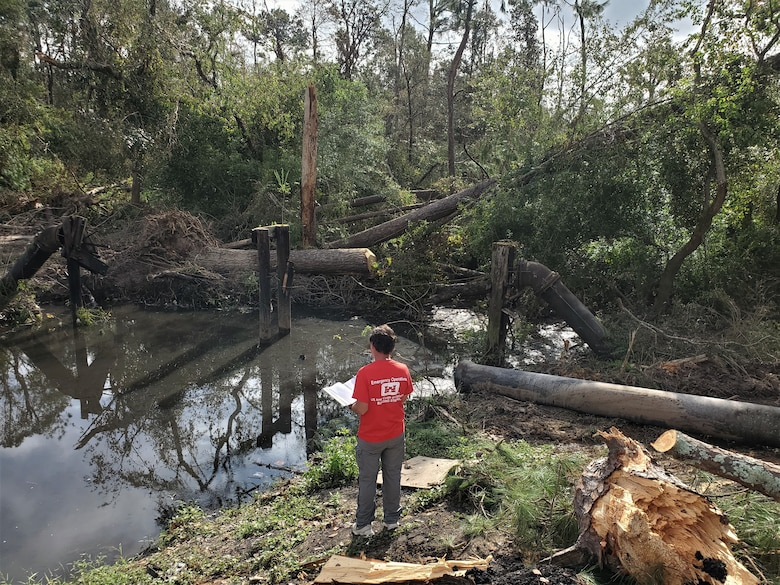 IN THE PHOTO, a member of the Infrastructure Assessment Planning and Response Team assess an area damaged by Hurricane Laura in southwestern Louisiana. The Corps evaluated a total of 52 fire stations, 53 water and wastewater facilities, and one hospital while deployed to Louisiana. (Courtesy photo)