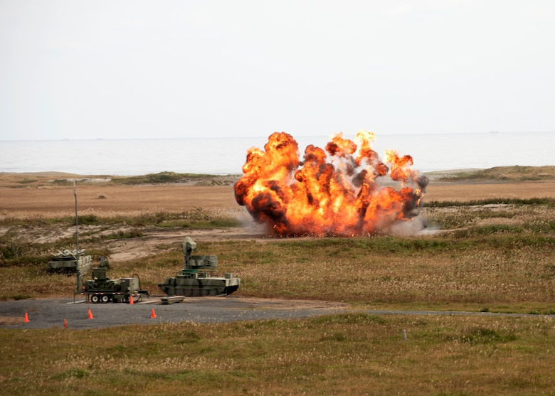An explosion is seen on a grassy field