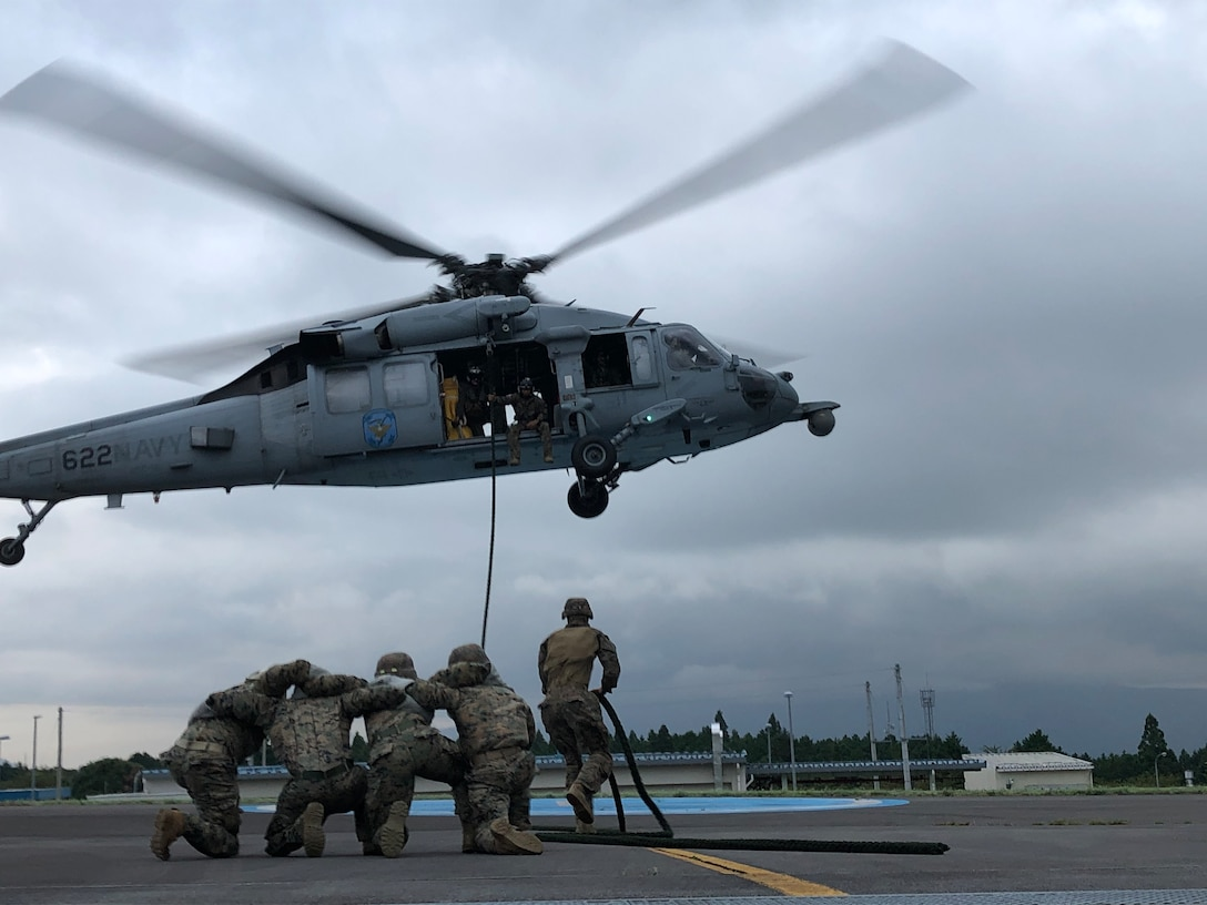U.S. Marines conduct Helicopter Rope Suspension Techniques with U.S. Navy Helicopter Sea Combat Squadron 12 on the Combined Arms Training Center Camp Fuji Airfield, Sept. 16.