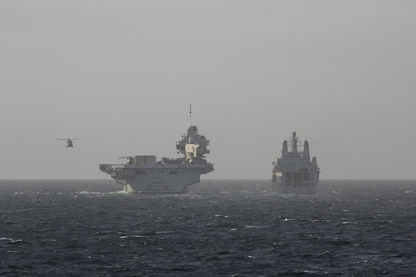 200930-N-N0901-004 NORTH SEA (Sept. 30, 2020) Royal Fleet Auxiliary RFA Fort Victoria (A387), right, joins the Royal Navy aircraft carrier HMS Queen Elizabeth (R08) and the Queen Elizabeth Carrier Strike Group in the North Sea during Exercise Joint Warrior 20-2, Sept. 30, 2020. Exercise Joint Warrior 20-2 is a U.K.-hosted, multilateral training exercise designed to provide NATO and allied forces with a unique multi-warfare environment to prepare for global operations. U.S. Naval Forces Europe-Africa/U.S. Sixth Fleet, headquartered in Naples, Italy, conducts the full spectrum of joint and naval operations, often in concert with allied and interagency partners, in order to advance U.S. national interests and security and stability in Europe and Africa. (U.S. Navy photo by Sonar Technician (Surface) 2nd Class Bethany Fults/Released)