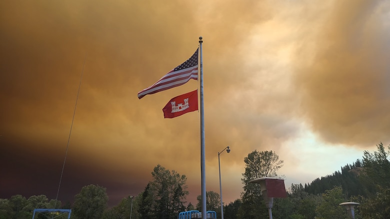 The American and U.S. Army Corps of Engineers flags fly above Foster Dam Sept. 11 as heavy plumes of smoke from wildfires across the Willamette Valley dominates the horizon and the sky above.