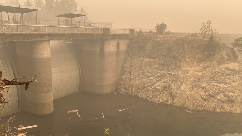 Smoke hangs heavy in the air around the Blue River Dam spillway Sept. 14; just days after the Holiday Farm Fire burned through the area; impacting Blue River and nearby Cougar Dam.
