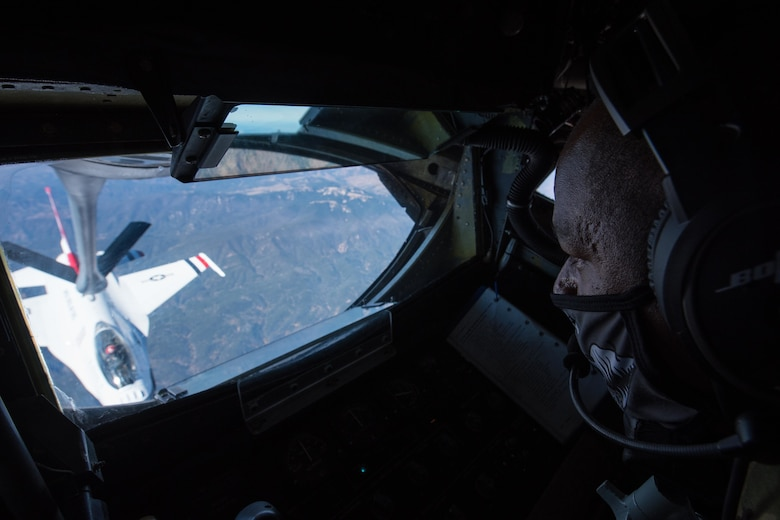Tech. Sgt. Bobby Jones, 350th Air Refueling Squadron in-flight refueling specialist, uses the boom of a KC-135 Stratotanker to transfer fuel to an F-16 Fighting Falcon Thunderbird Oct. 15, 2020, through the skies of New Mexico. The KC-135 passed off fuel to the Thunderbirds, allowing for a quick, non-stop route between destinations. ((U.S. Air Force photo by Senior Airman Alexi Bosarge)