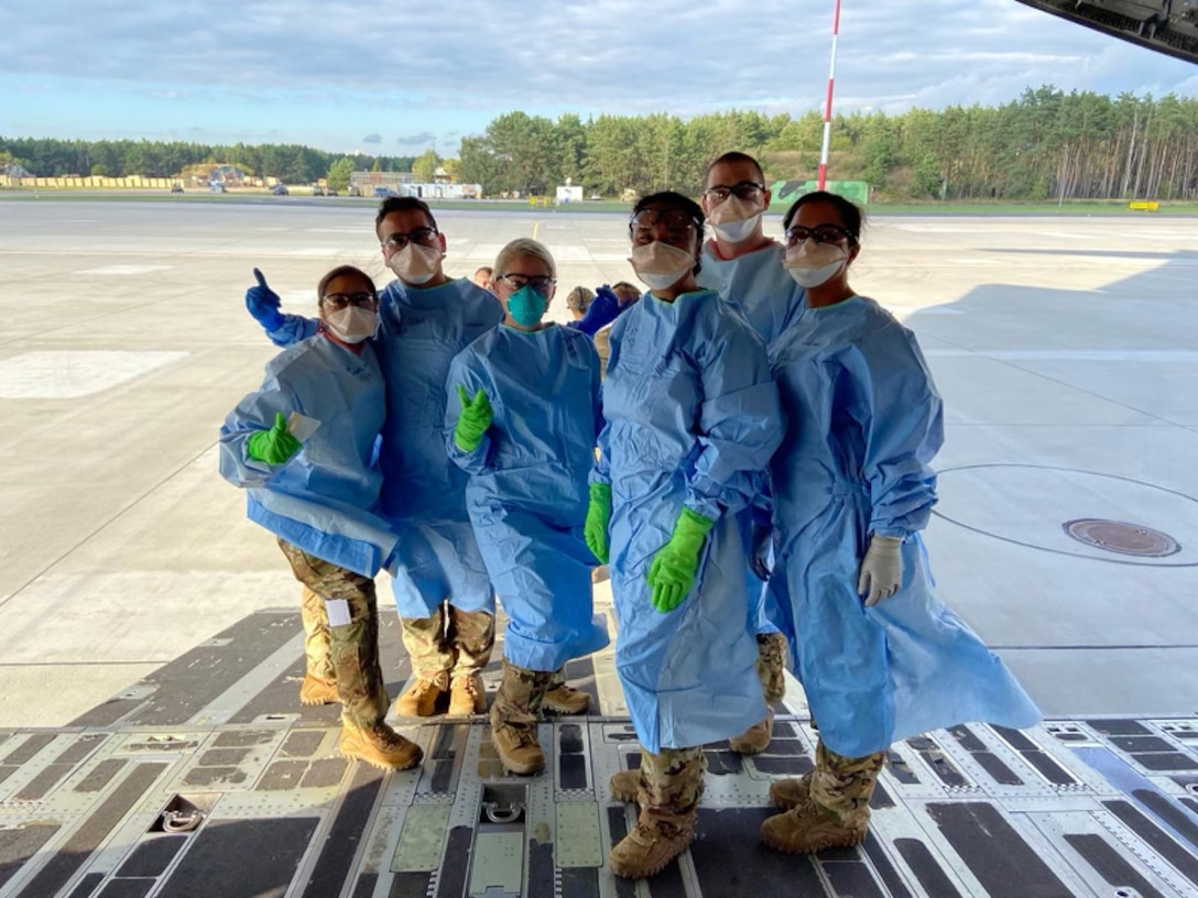 Capt. Alyssa Sandquist (far left), flight nurse for the 36th Aeromedical Evacuation Squadron at Keesler Air Force Base, gives a thumbs up as she and her fellow crew members prepare to work alongside COVID-19 patients on a C-17 Globemaster. From April to September 2020, Sandquist was a part of the 10th Expeditionary Aeromedical Evacuation Flight at Ramstein Air Base, Germany where she helped transport COVID-19 positive individuals to proper care facilities. (Courtesy Photo)
