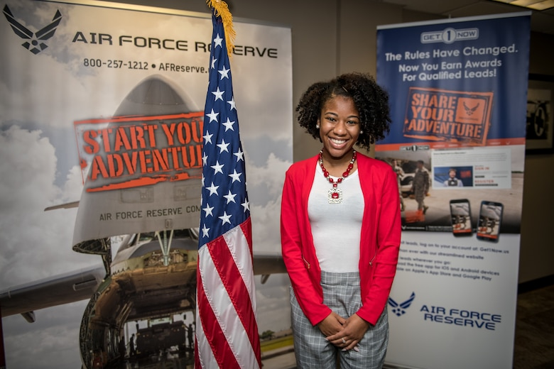 """Dominique Burrell poses for a photo  Oct. 2 2020, following an enlistment ceremony at the 932nd AW Headquarters building, Scott Air Force Base, Illinois. Burrell will continue her family's military legacy. """"I will become part of a bigger family,"""" said Burrell """"I hope to someday become an officer and look forward to what the Air Force has to provide [me], such as resiliency.""""  (U.S. Air Force photo by Christopher Parr)"""