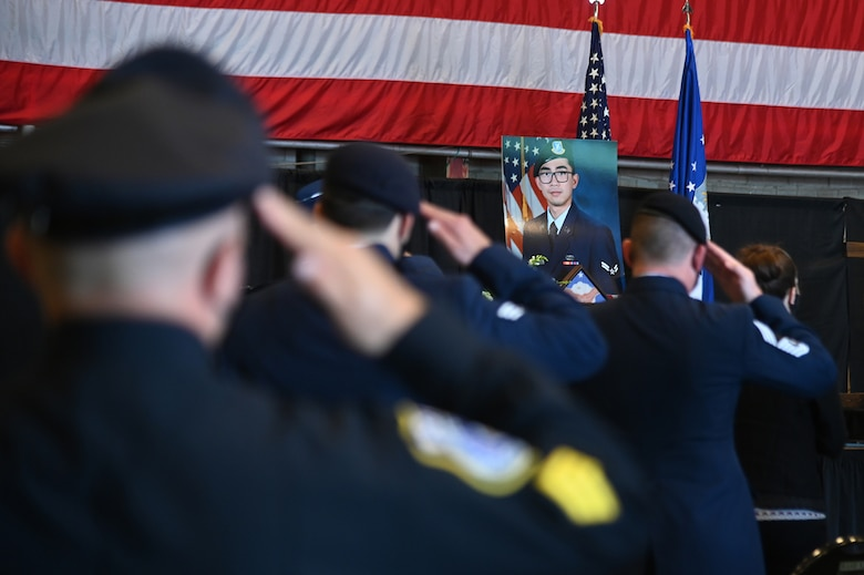 """Members of the 66th Security Forces Squadron salute during Senior Airman Jason """"Khai"""" Phan's memorial service at Hanscom Air Force Base, Mass., Oct. 16. During the ceremony, wingmen remembered the fallen Airman, who died in a non-combat incident Sept. 12 while serving overseas. (U.S. Air Force photo by Linda LaBonte Britt)"""