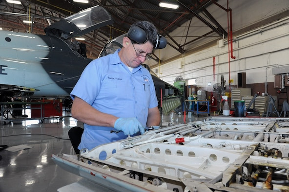 Ruben Pesina,12th Maintenance Group, repairs a panel from a T-38C Talon aircraft during a phase inspection at Joint Base San Antonio-Randolph. A trainer aircraft maintenance training center in Hangar 62 at JBSA-Randolph will soon be producing a new generation of trainer aircraft technicians to serve Air Education and Training Command.