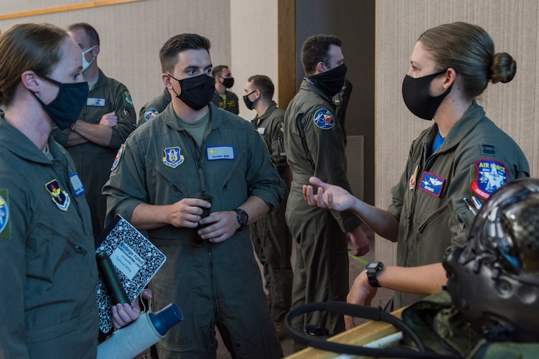 """Capt. Kristin Wolfe, F-35A demonstration team pilot, a Laughlin graduate of SUPT class 12-15, talks about life as a fighter pilot to 47th Student Squadron students, 2nd Lt. Samantha Ess and 2nd Lt. Hayden Gebo. """"We hope this was an exciting, encouraging experience for all of the students,"""" said Wolfe. """"Our goal is to provide a fighter pilot perspective while also giving an overview of the jet's capabilities to motivate future Air Force pilots."""" (U.S. Air Force photo by Senior Anne McCready)"""