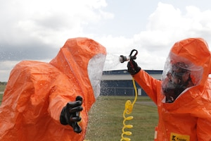 Members of the 52nd Civil Support Team (Weapons of Mass Destruction) decontaminate survey team personnel after exposure to an unknown agent during an exercise on Sept. 28, 2020, at the Fairfield County Airport, in Carroll, Ohio.
