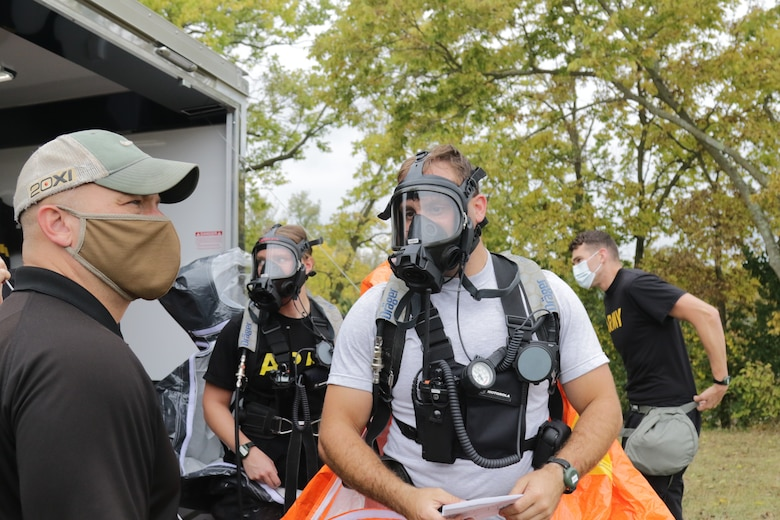 Members of the 52nd Civil Support Team (Weapons of Mass Destruction) discuss the plan to evaluate a suspected contaminated building during an exercise on Sept. 28, 2020, at the Fairfield County Airport in Carroll, Ohio.