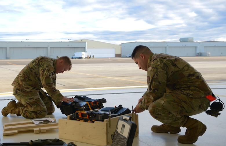 U.S. Air Force Tech. Sgt. Rylee James, right, a 354th Maintenance Squadron (MXS) Aircrew Egress F-35A Lightning II cadre member, and Staff Sgt. Victor Benitez, a 354th MXS Aircrew Egress journeyman, work on the new arctic survival seat kit for the F-35A on Eielson Air Force Base, Alaska, Sept. 28, 2020.