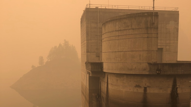 Smoke hangs heavy in the air around the Cougar Dam intake tower Sept. 11, just days after the Holiday Farm Fire burned through the area, impacting Cougar and nearby Blue River Dam.