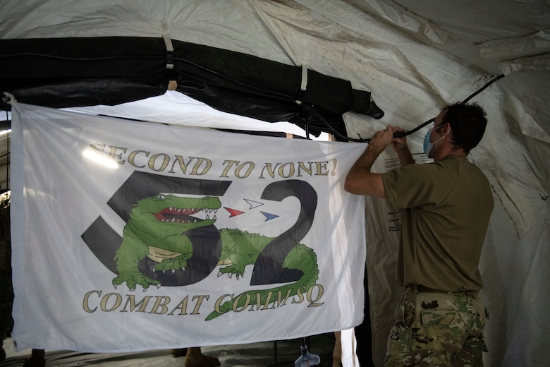 man hangs up a flag