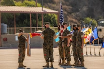 Lt. Col. Jonathan Peterson, commanding officer of 1st Landing Support Battalion dawn the colors during 1st LSB's activation ceremony.