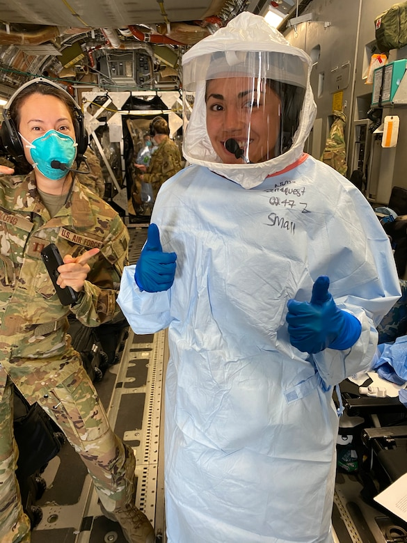 Capt. Alyssa Sandquist, flight nurse for the 36th Aeromedical Evacuation Squadron at Keesler Air Force Base, Mississippi, gives a thumbs up as she prepares to work alongside COVID-19 patients on a C-17 Globemaster. (Courtesy Photo)