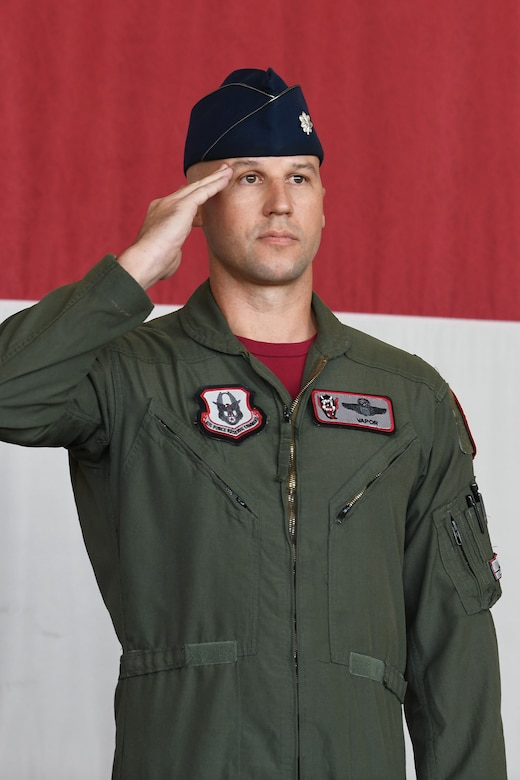 """Lt. Col. Paul """"Ballz"""" Killeen relinquished command to Lt. Col. Bradley """"Vapor"""" Sullivan, the new 69 FS commander. The ceremony was presided over by Col. Trena Savageau, 944th Operations Group commander."""