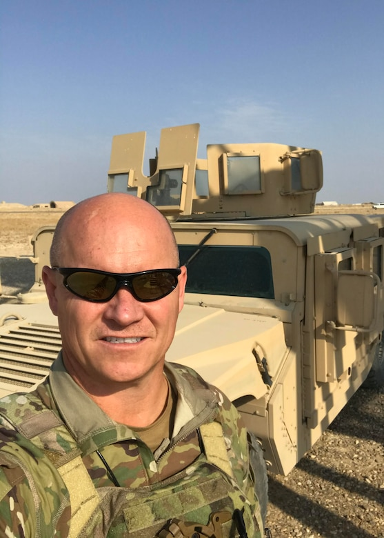 Senior Master Sgt. Rick Johnson, 69th Aerial Port Squadron operations flight chief, poses for a photo while on deployment to Baghdad, Iraq. Johnson was recently awarded the Bronze Star and Air Force Commendation Medal for his heroic efforts and meritorious achievement while deployed in support of Operation Inherent Resolve. (Courtesy Photo)