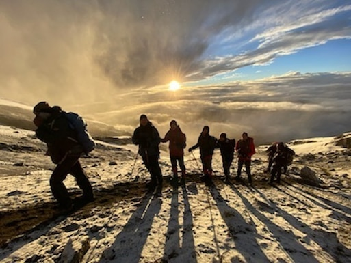 Col. Mike Binetti, sixth from left, and his friends ascend the snowy part of Kilimanjaro.