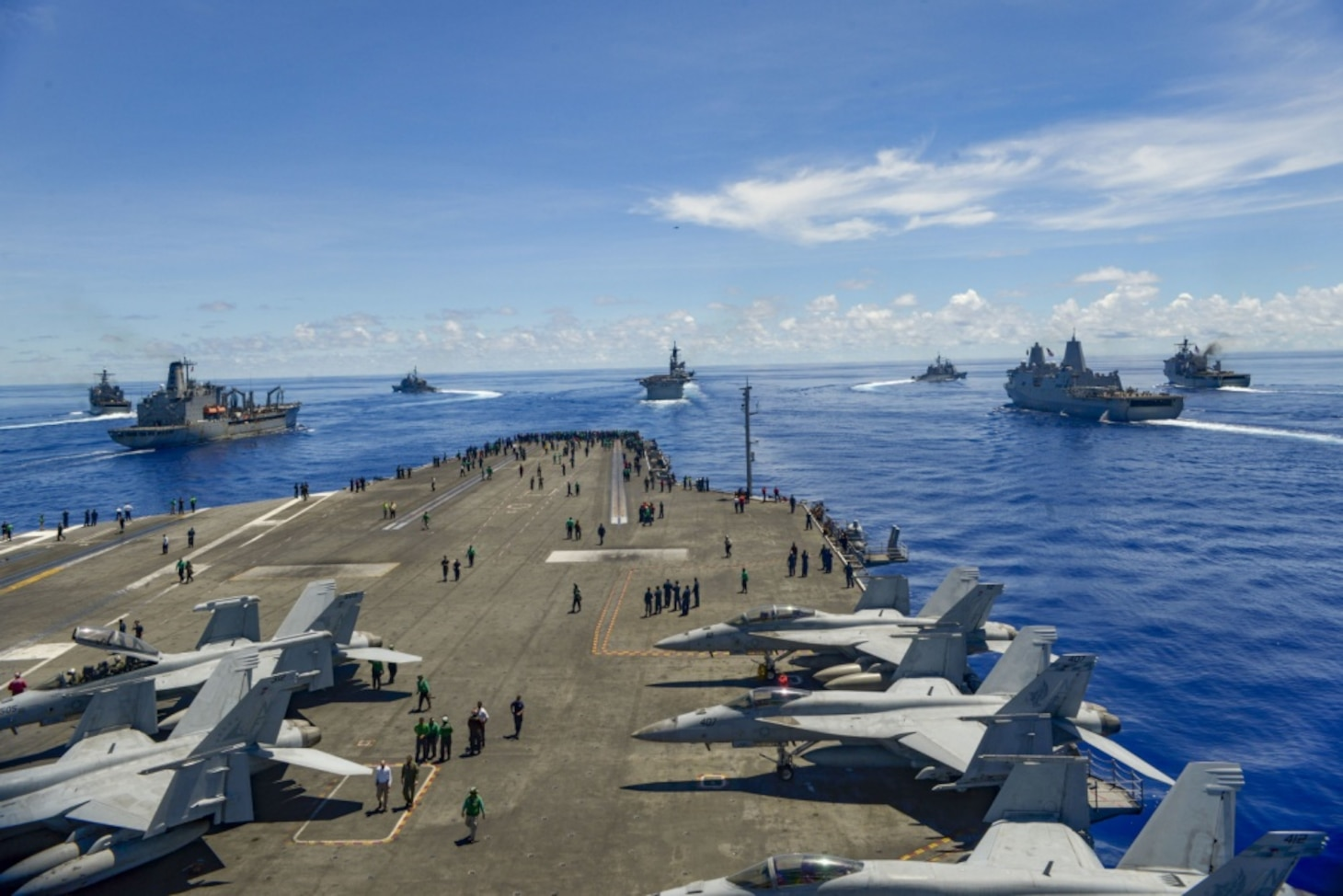 From left, USS Germantown (LSD 42), USNS John Ericsson (T-AO 194), USS Antietam (CG 54), USS Ronald Reagan (CVN 76), USS America (LHA 6), USS Shiloh (CG 67), USS New Orleans (LPD 18), and USS Comstock (LSD 45) break away from formation in support of Valiant Shield 2020. Valiant Shield is a U.S. only, biennial field training exercise (FTX) with a focus on integration of joint training in a blue-water environment among U.S. forces. This training enables real-world proficiency in sustaining joint forces through detecting, locating, tracking and engaging units at sea, in the air, on land and in cyberspace in response to a range of mission areas.
