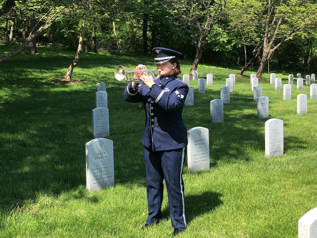 SrA Katherine Tonkin performing Taps on Memorial Day