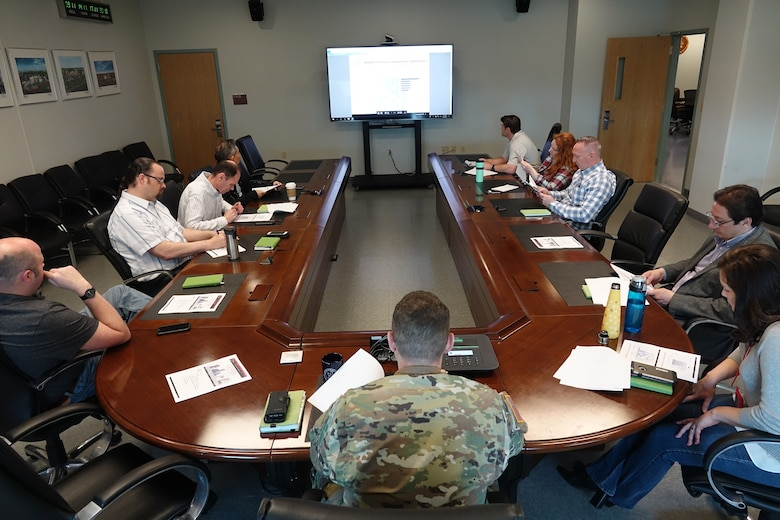 Lt. Col. McGee is seen here holding a traditional staff meeting with his team in Pre-Covid 19 conditions.
