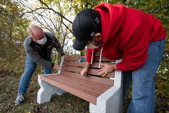 It was along the side of a small road in Binsfeld, among the newly fallen leaves and the cool, autumn air that Liliana, her husband, Javier, and several family members began constructing a bench Oct. 10