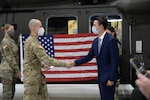 Lars Olson recites the enlistment oath at the headquarters of 3rd Battalion, 142nd Aviation at Army Aviation Support Facility #3, in Latham, N.Y. Olson will be the first