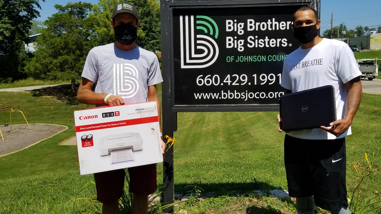 A 509th Logistics Readiness Squadron fire truck and refueling maintenance team worked with Big Brothers Big Sisters of Johnson County to fundraise equipment to help approximately 20 students continue their online education.