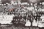 a few hundred men and women standing and sitting in 1920's clothing looking towards the camera. Some are doctors and nurses others labors.