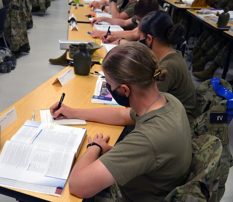 Students in the Combat Medic Specialist Training Program, or CMSTP, second training shift take notes during a lecture in the Emergency Medical Technician course.