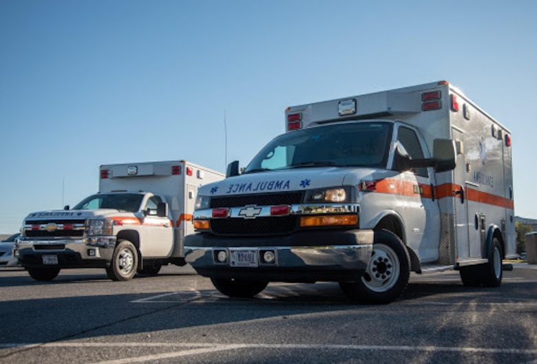 Image of ambulances sitting outside of the base theater.