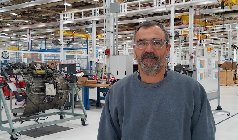 Photo of man in an engine shop