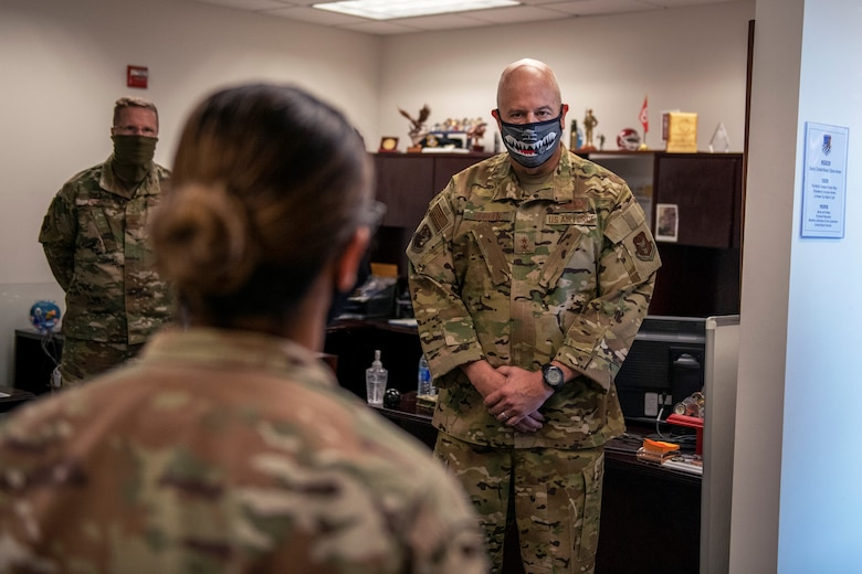 Maj. Gen. Brian Borgen, 10th Air Force commander, speaks with Senior Master Sgt. Dolores Beard, superintendent of plans and programs in the 419th Security Forces Squadron