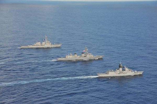 SOUTH CHINA SEA (Oct. 20, 2020) - The Arleigh Burke-class guided-missile destroyer USS John S. McCain (DDG 56) (rear), Japanese Maritime Self-Defense Force (JMSDF) ship JS Kirisame (DD 104) (middle), and Royal Australian Navy ship HMAS Arunta (FFH 151) (front) sail together in the South China Sea during multinational exercises. These exercises marked the fifth time of 2020 that Australia, Japan, and the U.S. have conducted operations together in the 7th Fleet area of operations.