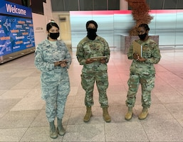 Members of the New York National Guard help state Department of Health officials screen travelers at JFK Airport in New York City Oct. 16. 2020. Travelers arriving from states with significant community spread are advised to quarantine for 14 days as a precaution.