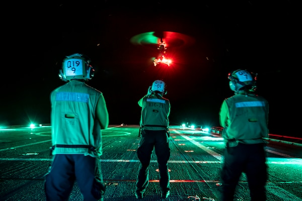 Sailors assigned to the �Wildcards� of Helicopter Combat Squadron (HSC) 23 watch as an MQ-8B Fire Scout takes off aboard the Independence-class littoral combat ship USS Gabrielle Giffords (LCS 10) Oct. 10, 2020.