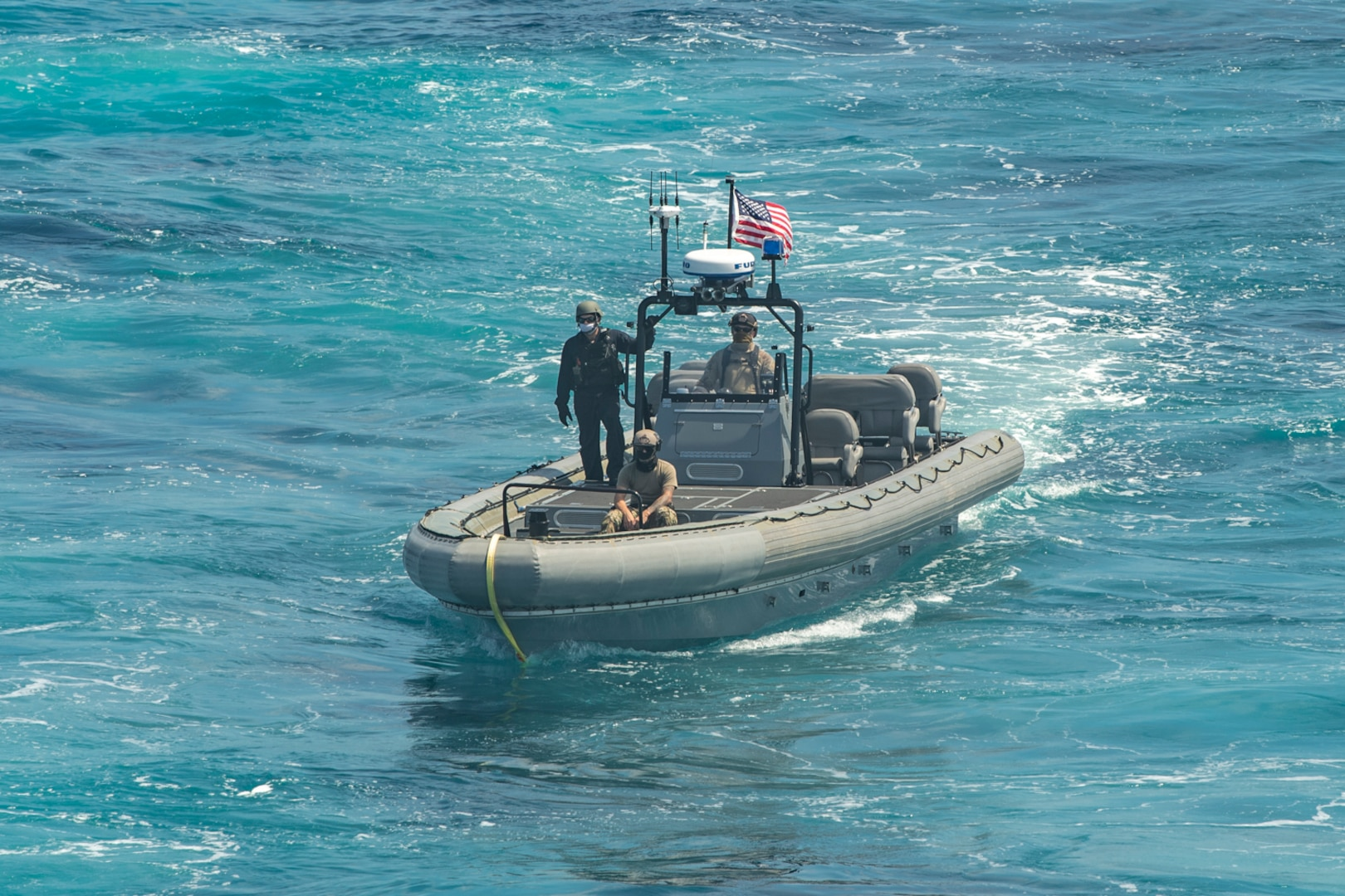 Sailors and Coast Guardsmen conduct small boat operations aboard the Independence-class littoral combat ship USS Gabrielle Giffords (LCS 10) Oct. 10, 2020.
