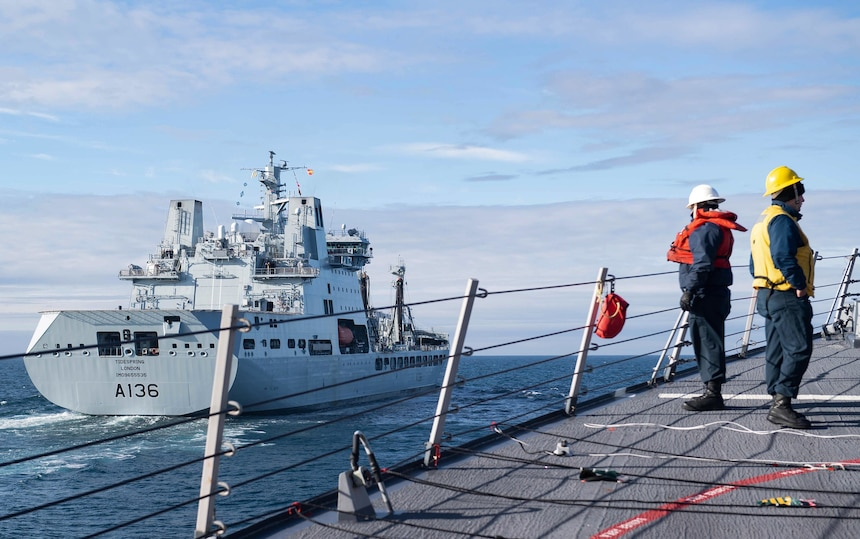 200909-N-TC847-1006 BARENTS SEA (Sept. 9, 2020) Sailors assigned to the Arleigh Burke-class guided-missile destroyer USS Ross (DDG 71) approach the British Royal Fleet Auxiliary tanker RFA Tidespring (A136) for a replenishment-at-sea in the Barents Sea, Sept. 9, 2020. Ross is conducting maritime security operations in the Barents Sea as part of a Surface Action Group with the Royal Navy and Royal Norwegian Navy. (U.S. Navy photo by Mass Communication Specialist Seaman Christine Montgomery)