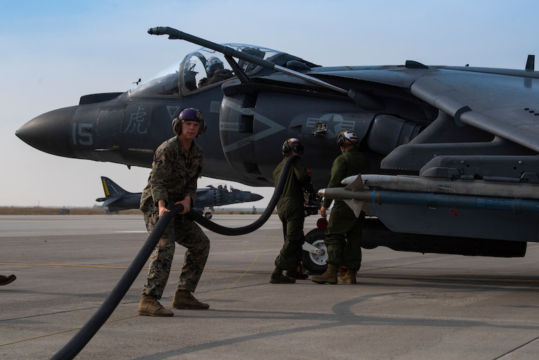 U.S. Marine power liners prepare to refuel an AV-8B II Harrier, at Mountain Home Air Force Base, Idaho, Oct. 8, 2020. Marine Attack Squadron 542 and Marine Wing Support Squadron 271 worked closely with 366th Logistics Readiness Squadron fuels flight and provided aviation fuel, heavy equipment and utilities support for exercise Mountain Tiger. (U.S Air Force photo by Airman 1st Class Natalie Rubenak)