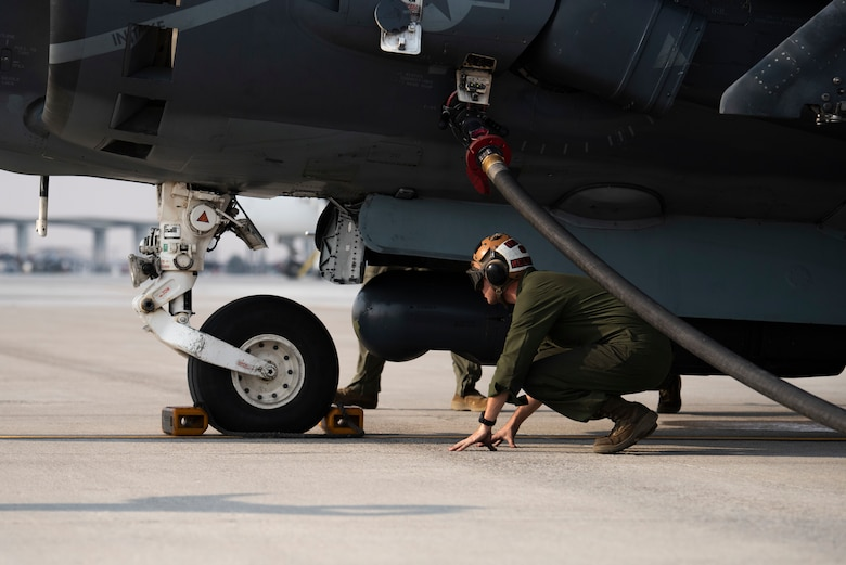 A U.S. Marine with Marine Attack Squadron 542, inspects a chock on an AV-8B II Harrier, at Mountain Home Air Force Base, Idaho, Oct. 8, 2020. VMA 542 and Marine Wing Support Squadron 271 worked closely with 366th Logistics Readiness Squadron fuels flight and provided aviation fuel, heavy equipment and utilities support for exercise Mountain Tiger. (U.S Air Force photo by Airman 1st Class Natalie Rubenak)