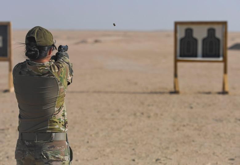 A U.S. Army Soldier fires a Beretta M-9 pistol at the Udairi Range Complex, Kuwait, Oct. 12, 2020.