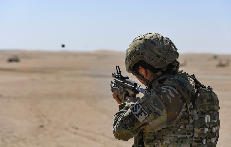 U.S. Air Force Airman 1st Class Miabella Contreras, 386th Expeditionary Security Forces Squadron Operations Raptor Flight response force leader, fires an MK-13 single grenade launcher at the Udairi Range Complex, Kuwait, Oct. 12, 2020.