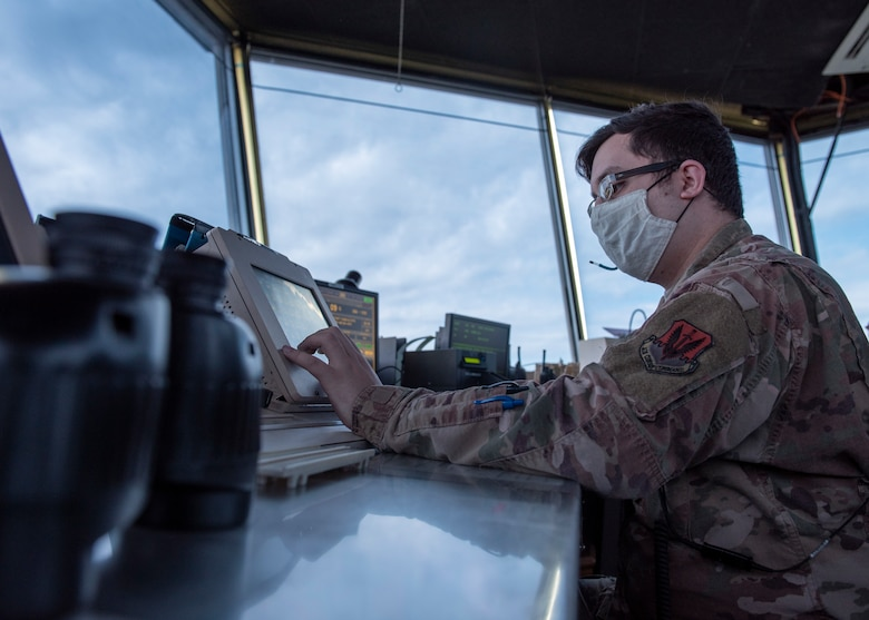 Senior Airman Elias De La Torre, 4th Operations Support Squadron air traffic control journeyman, uses an enhance terminal voice switch (ETVS) to communicate with base facilities, aircraft and flightline vehicles at Seymour Johnson Air Force Base, North Carolina, Oct. 2, 2020.