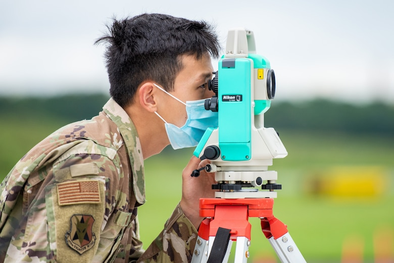 A photo of Staff Sgt. Kevin Tan looking through a Nikon NPL-322+ P Series Total Station.