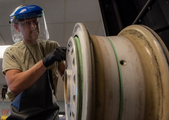 Senior Airman Lyman Patee, 4th Equipment Maintenance Squadron crash recovery wheel and tire craftsman, inspects and cleans the wheel of an F-15E Strike Eagle at Seymour Johnson Air Force Base, North Carolina, Oct. 14, 2020.