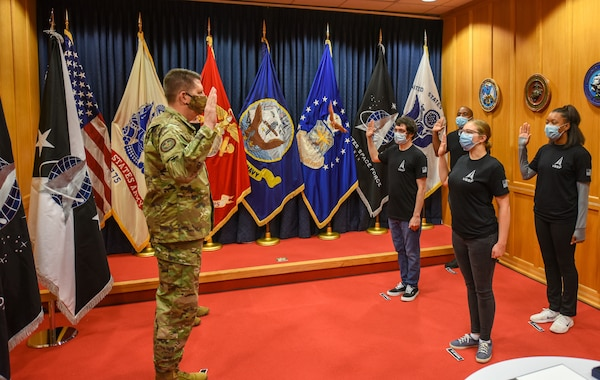 "The Vice Chief of Space Operations Gen. David D. ""DT"" Thompson swore in the first four Space Force recruits at the Baltimore Military Entrance Processing Command station, Fort George G. Meade, Maryland, Oct. 20, 2020. The first four recruits will join others from Colorado, placing them on a direct path to Basic Military Training at Joint Base San Antonio-Lackland and marking another milestone in the new service's growth and development."