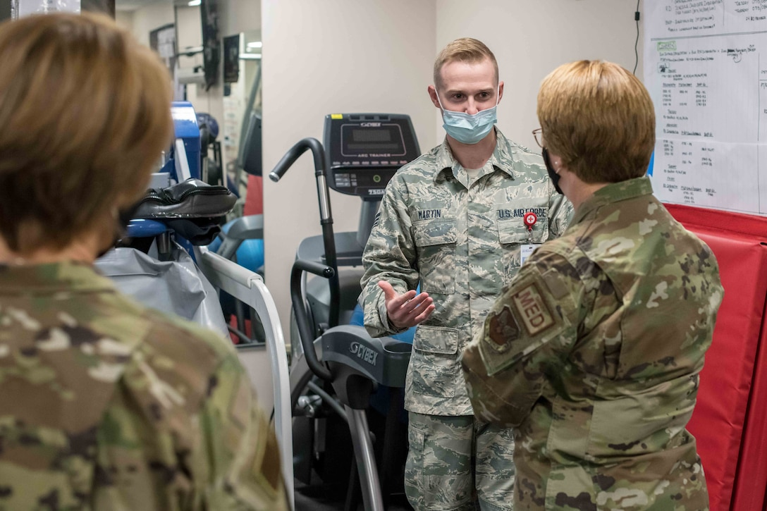 Lt. Gen. Dorothy Hogg (right), U.S. Air Force Surgeon General, and Chief Master Sgt. Dawn Kolczynski (left), Medical Enlisted Force chief, are briefed by Senior Airman Heath Martin, 22nd Operational Medical Readiness Squadron physical medicine technician, on the uses of the Anti-Gravity treadmill located in the 22nd Medical Group physical therapy clinic Oct. 15, 2020, at McConnell Air Force Base, Kansas. During the visit, Hogg toured the 22nd Medical Group facilities and connected with Team McConnell Airmen about their contribution to the 22nd ARW's global mobility mission. (U.S. Air Force photo by Senior Airman Skyler Combs)