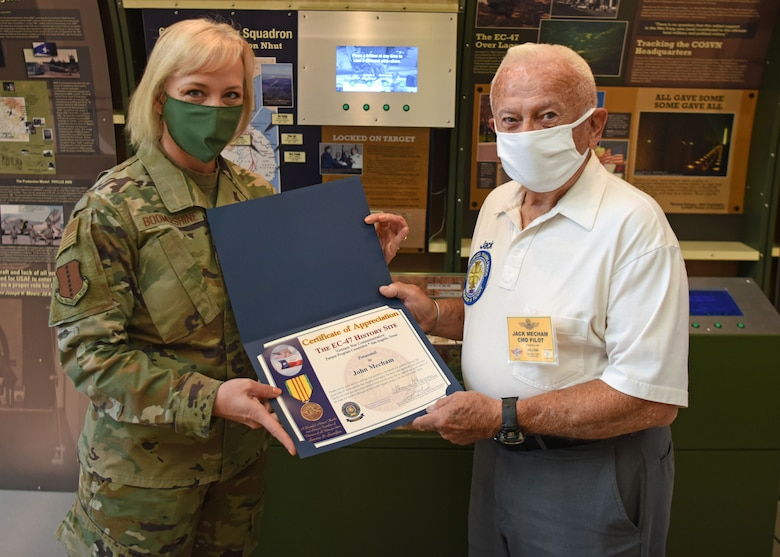 U.S. Air Force Chief Master Sgt. Casy Boomershine, 17th Training Wing command chief, presents  Ret. Col. Jack Mecham, former SR-71 pilot with a certificate of appreciation at Norma Brown on Goodfellow Air Force Base, Texas, Oct. 13, 2020. Mecham flew 23 different kinds of aircraft during his time in the Air Force. (U.S. Air Force photo by Airman 1st Class Ethan Sherwood)