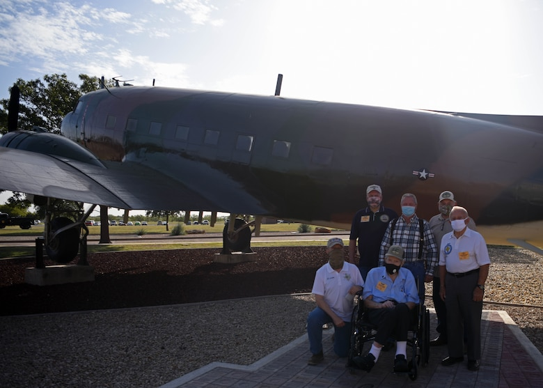 Vietnam Veterans and members of Goodfellow pose in front of the EC-47 Memorial on Goodfellow Air Force Base, Texas, Oct. 13, 2020. The ceremony was rescheduled to 2021, but the veterans came out early to see the pavers in advance. (U.S. Air Force photo by Airman 1st Class Ethan Sherwood)